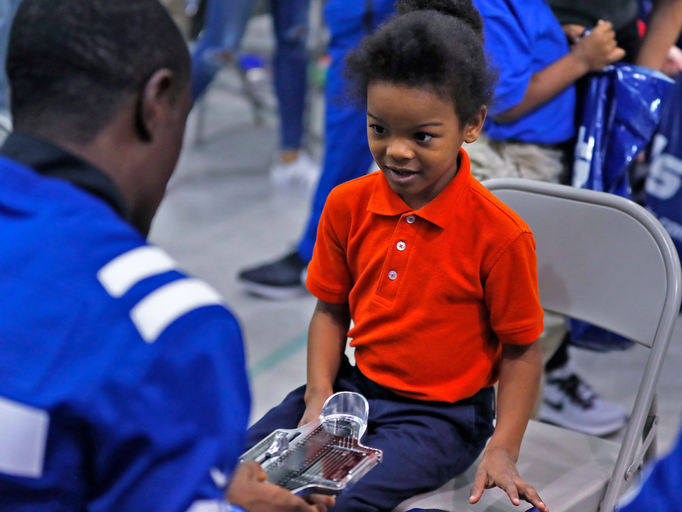 Shoe sizes are checked as kids receives new shoes at Brookside School 54, Monday, Dec. 3, 2018.  Colts players and staff joined as LIDS Sports and its parent company Genesco fit and gave new shoes, socks, hats, and snacks to students as part of the 13th annual Cold Feet, Warm Shoes event.