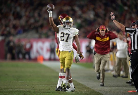 Notre Dame's Julian Love celebrates after breaking up a pass against the USC Trojans  on Nov. 24, 2018, at Los Angeles Memorial Coliseum.