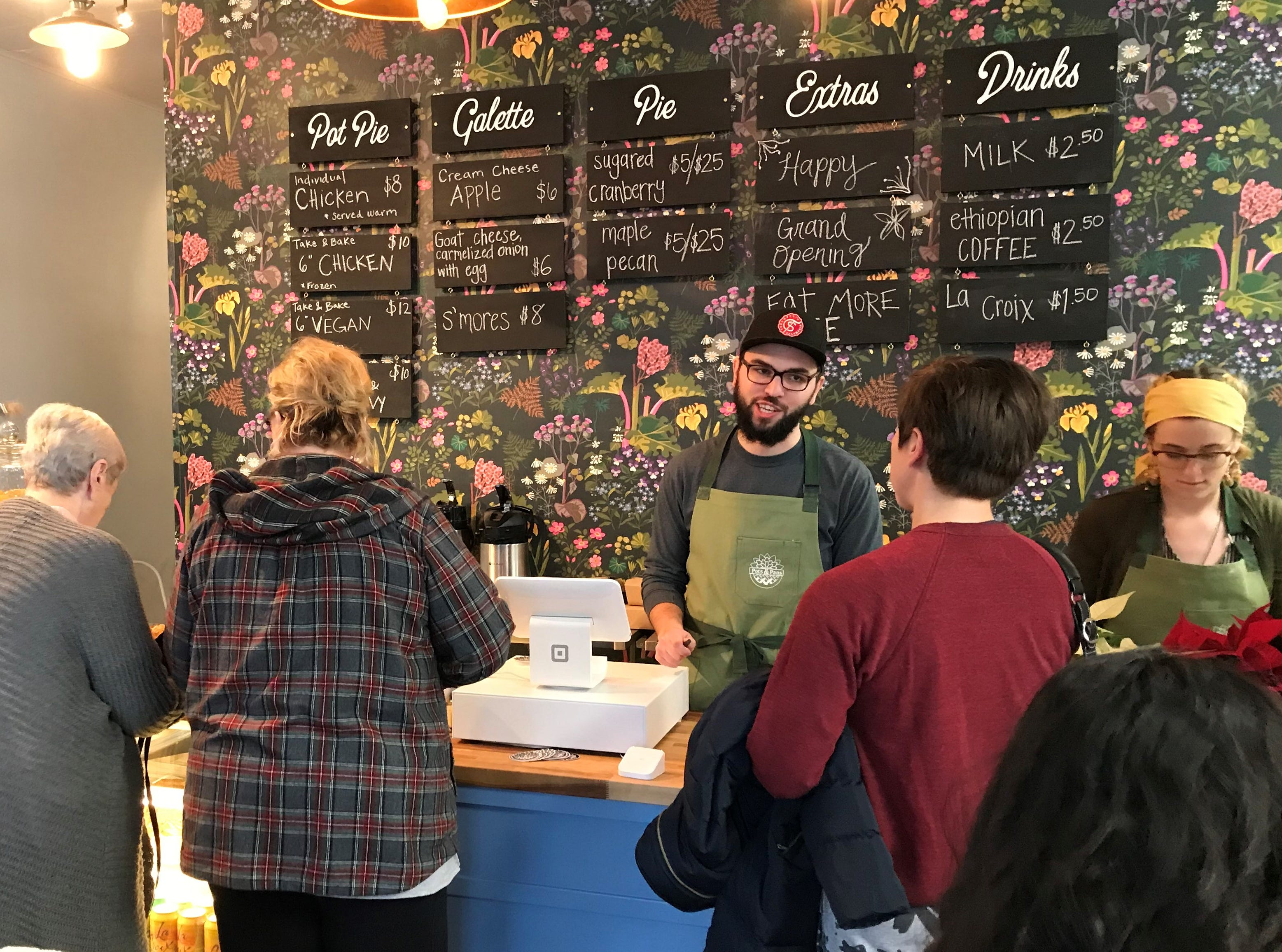 Crowds line up for sweet and savory pies at Pots & Pans Pie Company's grand opening Dec. 1, 2018. The store, south of Broad Ripple, is at 915 N. College  Ave., at 49th Street.