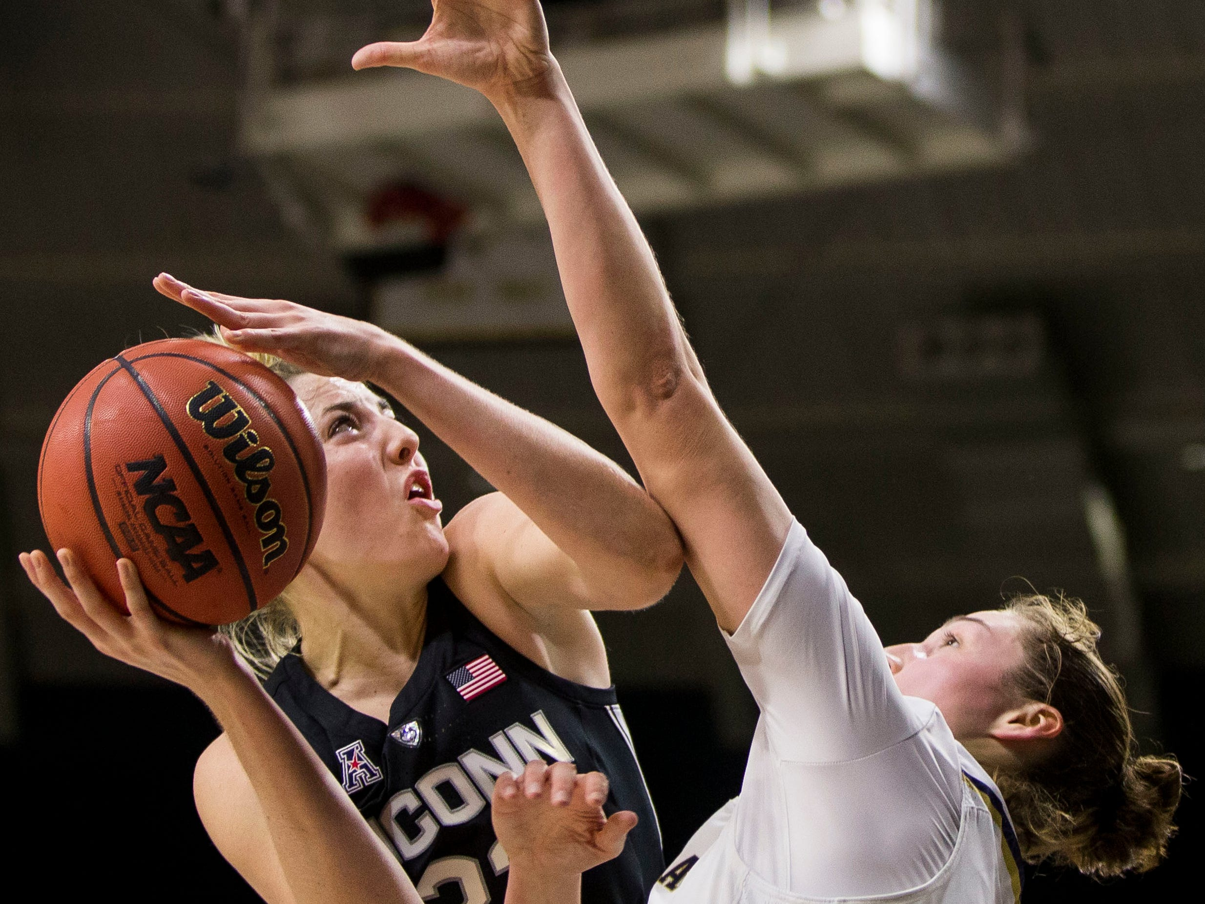 Connecticut's Katie Lou Samuelson, left, goes up for a shot with pressure from Notre Dame's Jessica Shepard during the first half of an NCAA college basketball game Sunday, Dec. 2, 2018, in South Bend, Ind.