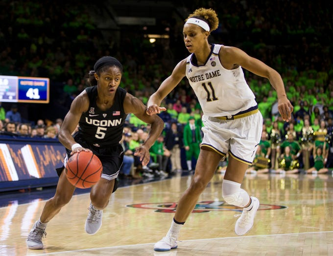 Connecticut's Crystal Dangerfield (5) drives by Notre Dame's Brianna Turner (11) during the first half of an NCAA college basketball game Sunday, Dec. 2, 2018, in South Bend, Ind.