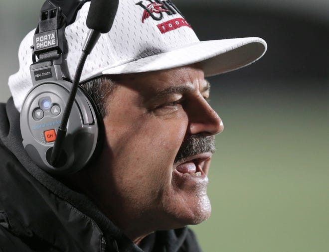 FILE -- UIndy head coach Bob Bartolomeo tries to fire up his players in the second half of the game on Thursday, Oct. 30, 2014. The Greyhounds won 36-33 in four overtimes.