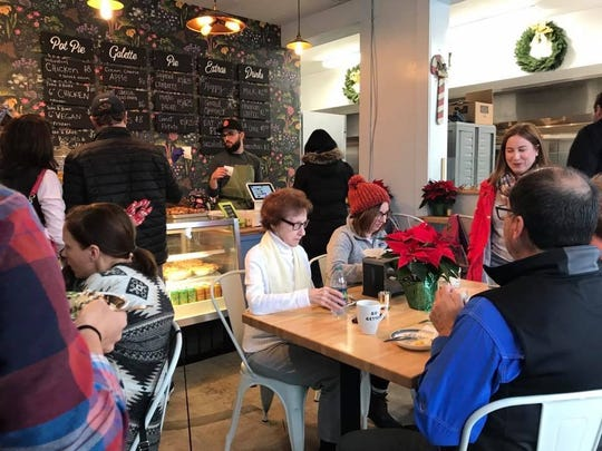 Customers dig into sweet and savory pies at Pots & Pans Pie Co. The bakery opened this cafe and retail shop Dec. 1, 2018. The store, south of Broad Ripple, is at 915 N. College  Ave., at 49th Street, Indianapolis.