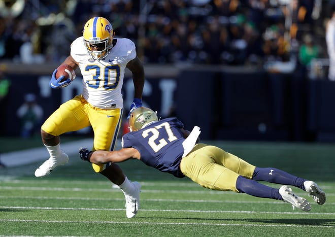 Notre Dame's Julian Love tackles Pittsburgh running back Qadree Ollison during a game Oct. 13, 2018, in South Bend.