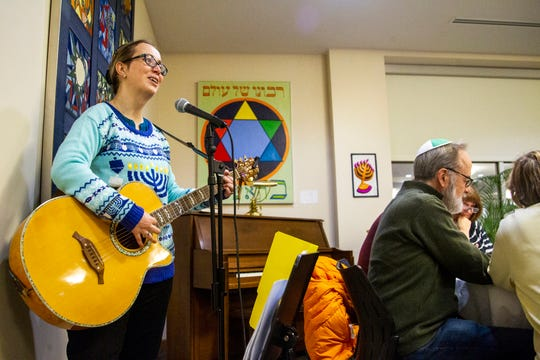 Rabbi Esther Hugenholtz sings a song during a Hanukkah celebration on Sunday, Dec. 2, 2018, at the Agudas Achim Congregation in Coralville.