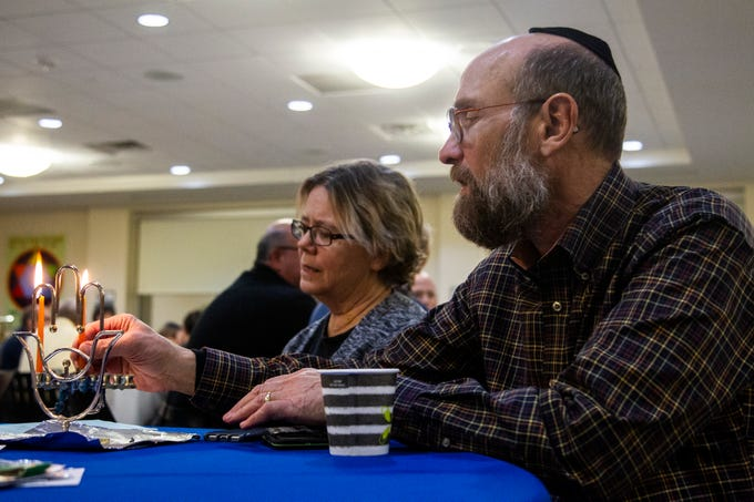Jody, right, and Janie light their menorah during a Hanukkah celebration on Sunday, Dec. 2, 2018, at the Agudas Achim Congregation in Coralville. Sunday was the first night of Hanukkah.