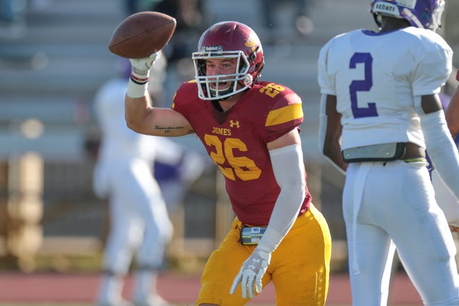 Jones College's John David Rutherford (26) celebrates recovering a fumble for the Bobcats in JC's Mississippi Bowl XI win Sunday afternoon.