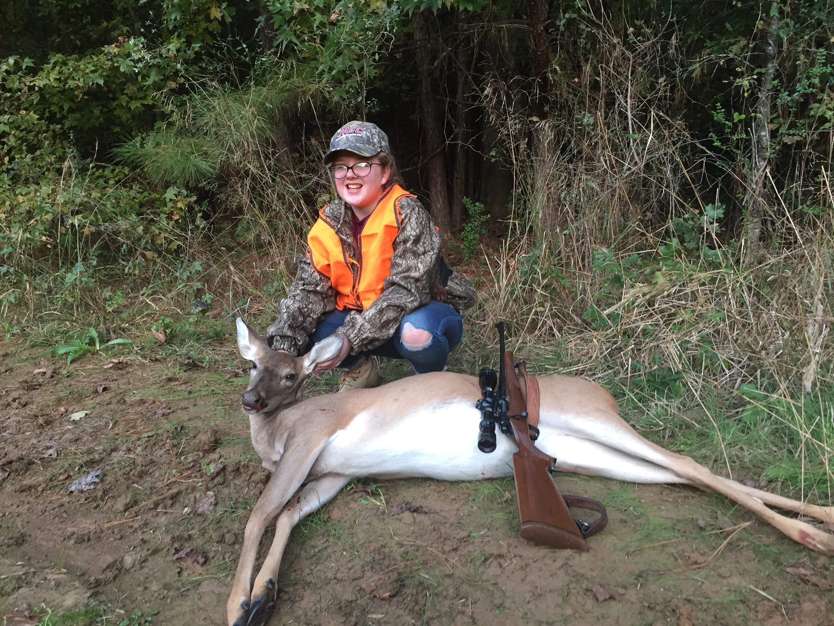 Lucy Pope, 11, of Clinton, harvested her first deer while hunting on family land with her grandfather.