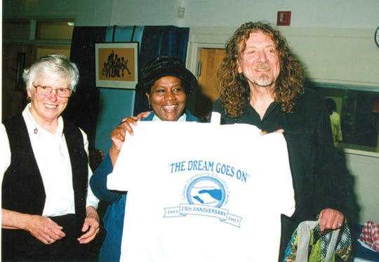 Led Zeppelin's Robert Plant in Tutwiler in 2009 for the Mississippi Blues Trial Marker unveiling marking the location W.C. Handy first heard blues being played. Here, Plant stands with Tutwiler Mayor Genether Miller-Spurlock and Holy Name of Jesus Sister Maureen Delaney.