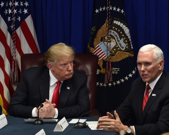Seated next to President Donald Trump, Vice President Mike Pence speaks to members of a roundtable on criminal justice reform held at the Mississippi Air National Guard base in Gulfport. The two plan to travel to Mississippi again in the coming week, this time for separate events.