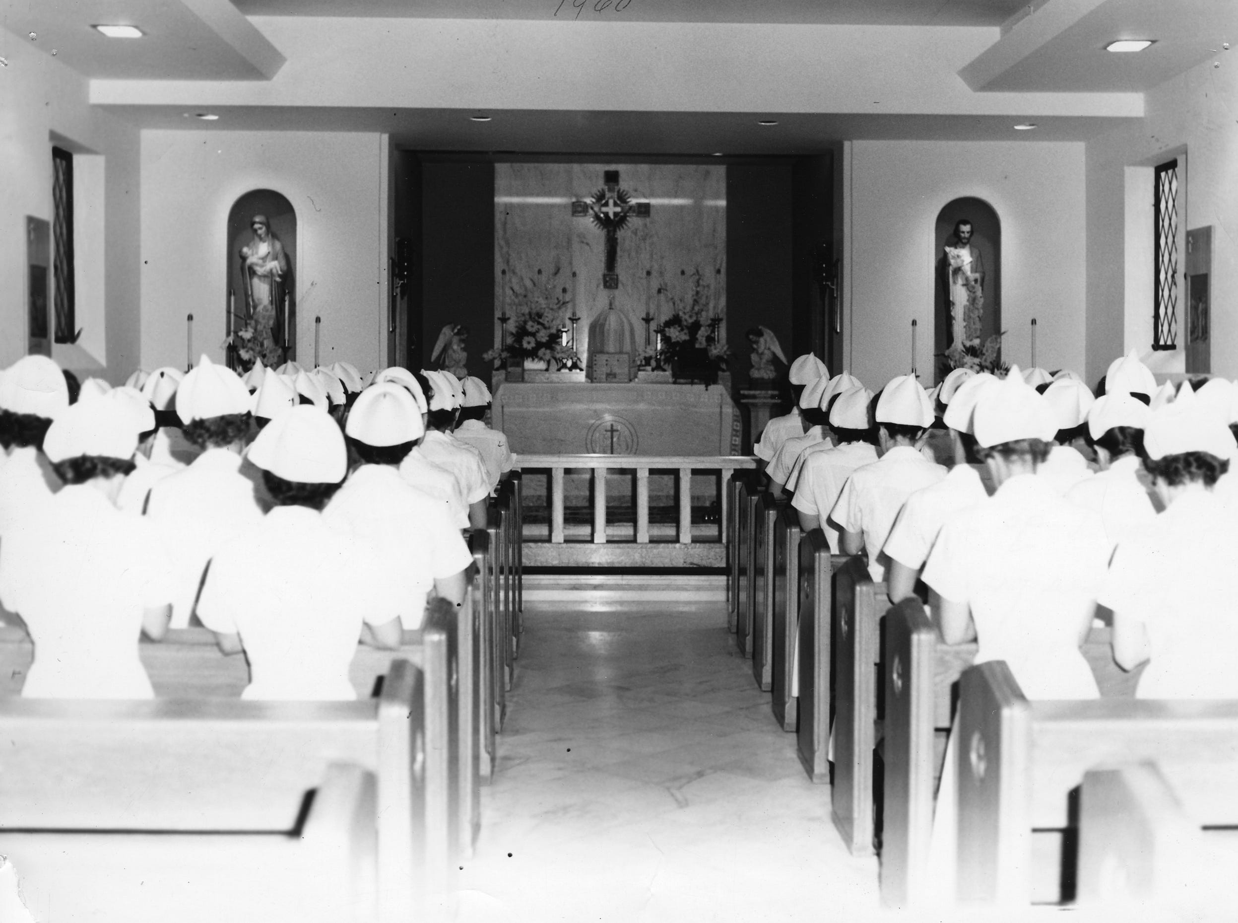 "Chapel morning prayer at St. Mary's, summer 1960. It was traditional for many years that student nurses who were to report for morning shift would go from breakfast to the chapel for prayers. Students were ""inspected"" as they left chapel to be sure that uniforms were clean, etc."