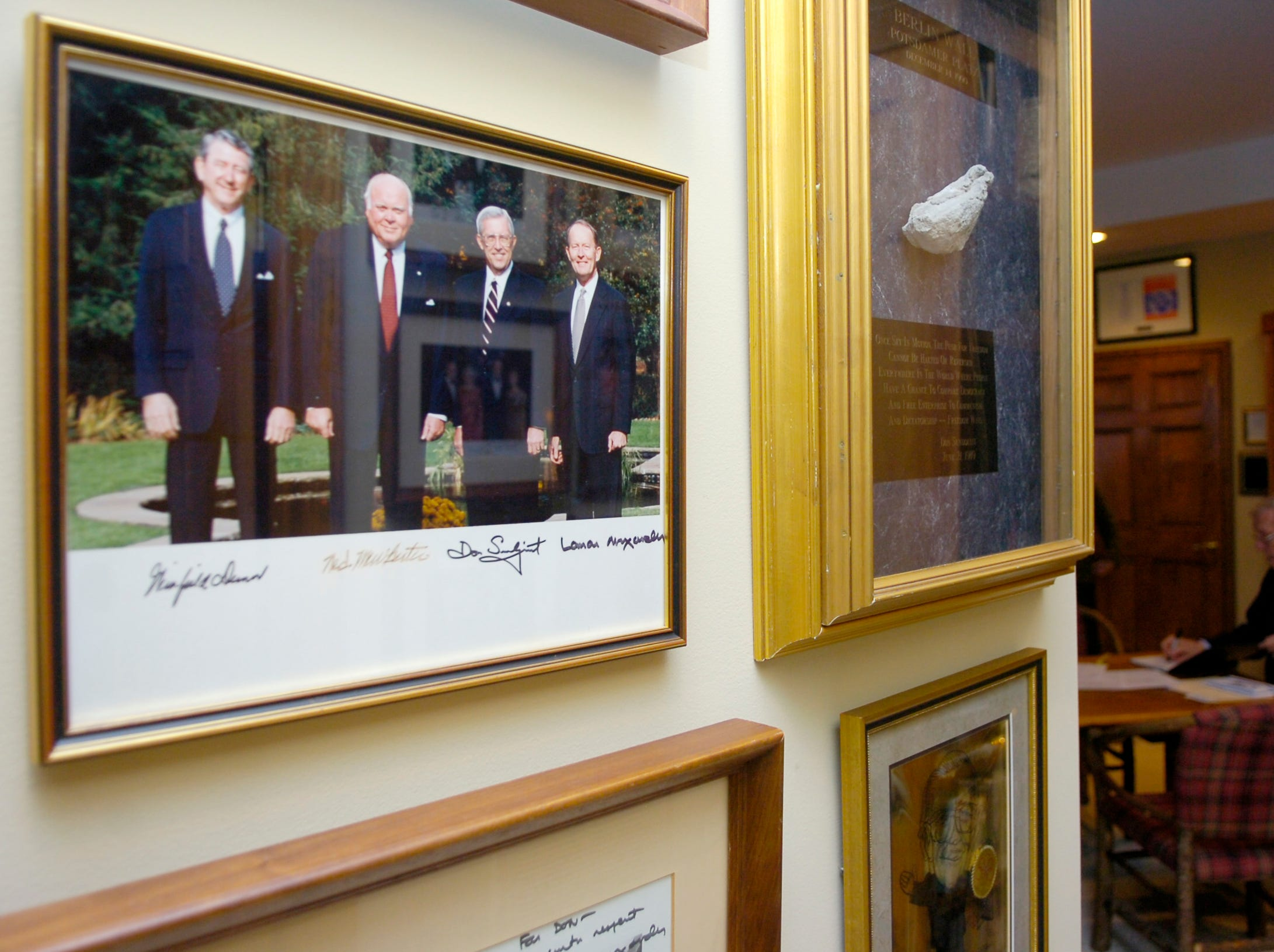 A photograph of former Tennessee Governor Don Sundquist along with Winfield Dunn, Ned McWHerter and Lamar Alexander hangs next to a piece of the Berlin Wall in his office area at his home in Laurel Valley, located in Townsend, TN. Sundquist served as governor from 1995 to 2002.