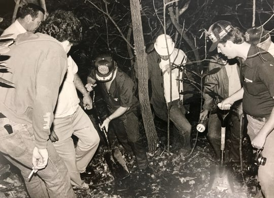 Nicky Sutton, left, helps authorities locate the body of a man he said he killed. At right is Martin Coffey, then a detective with the Hamblen County Sheriff's Office.