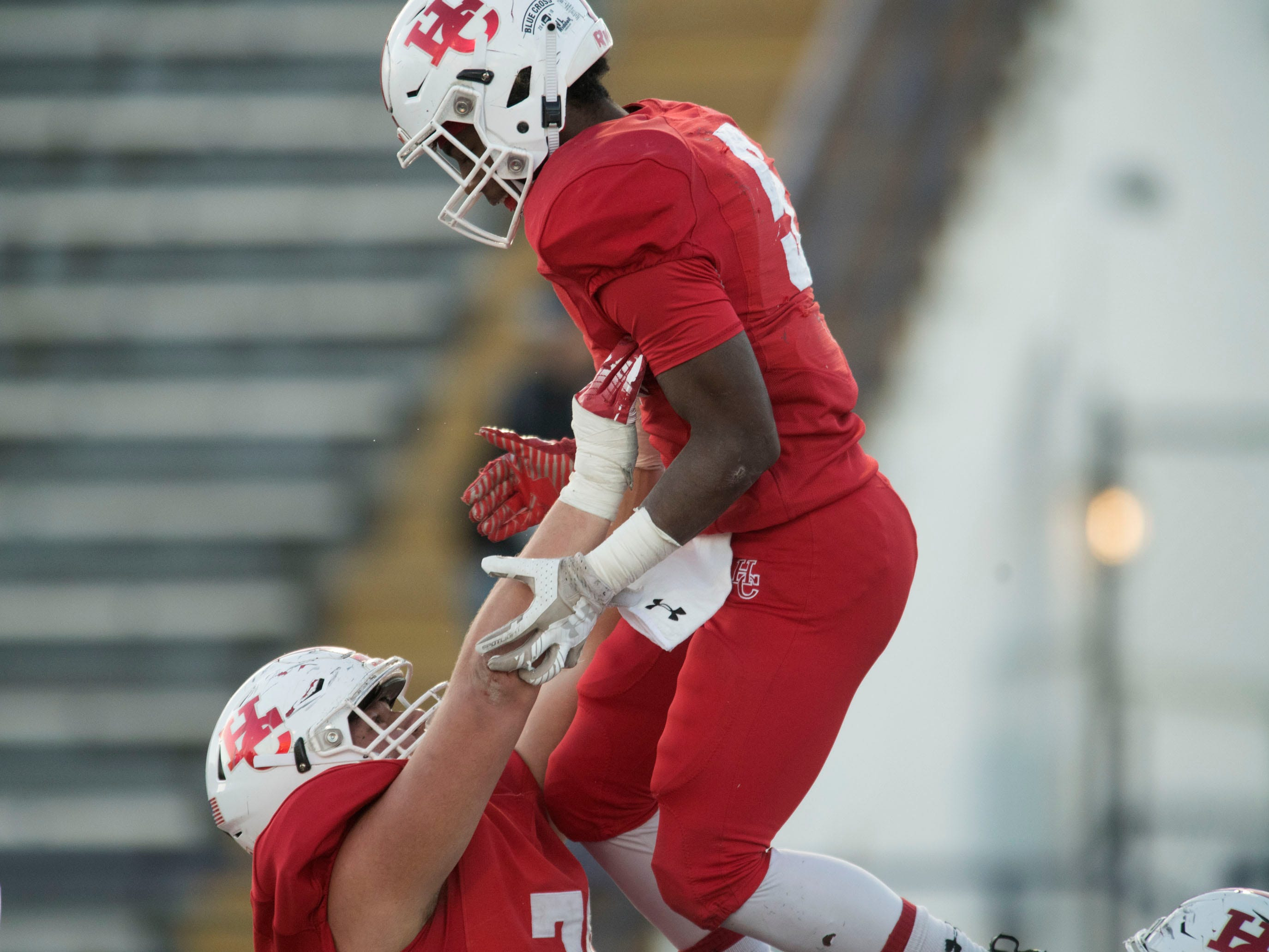 Henry County's Nick Metzinger (70) hoists Jaylon Foster (5)  in celebration of Foster's touchdown against Knoxville Central in the Class 5A BlueCross Bowl at Tucker Stadium on Sunday, December 2, 2018.