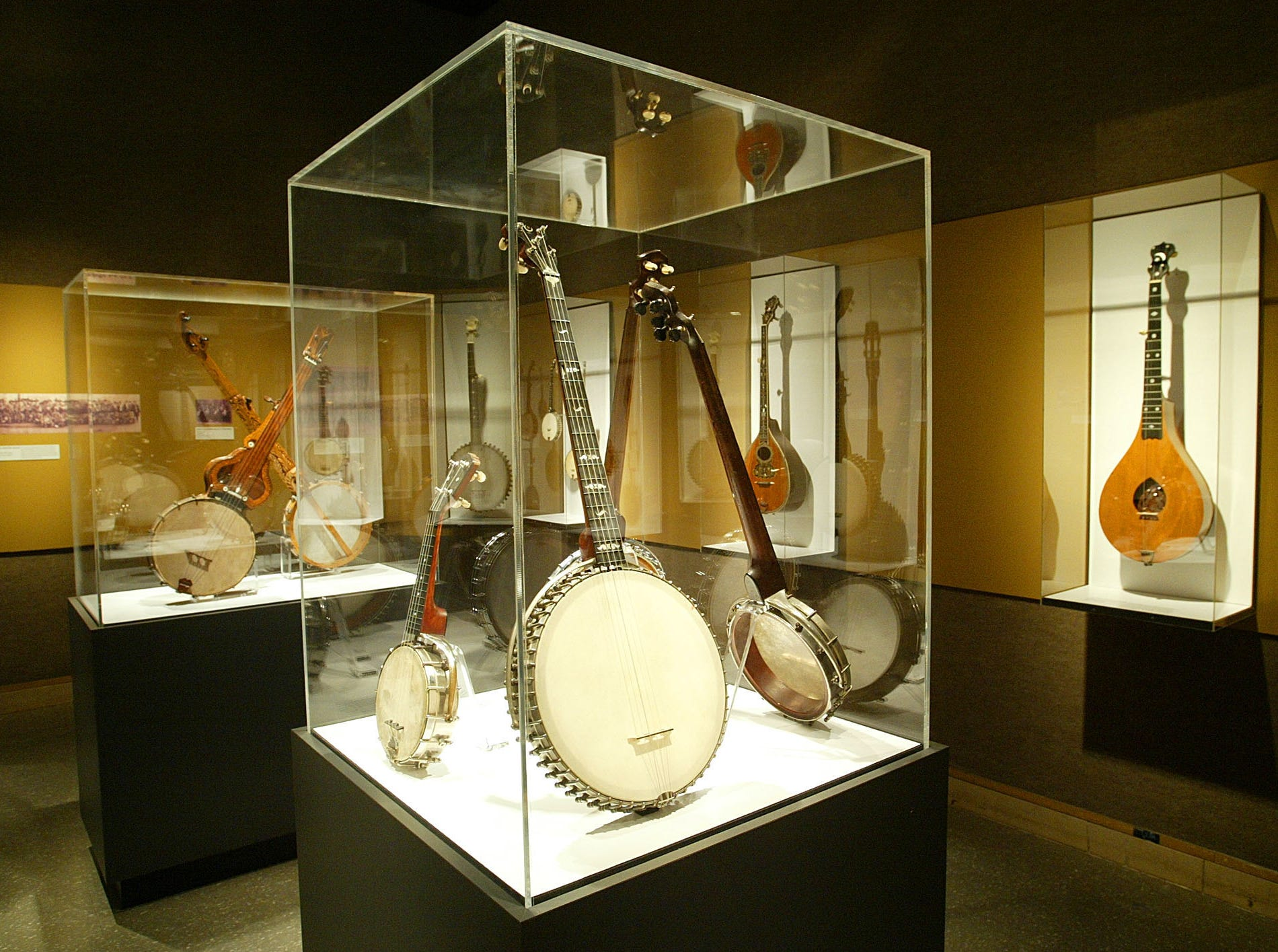 "Banjos of all shapes and sizes are shown Wednesday, Feb. 8, 2006, at the ""Banjo: From Africa to America and Beyond"" exhibit at the University of Tennessee's McClung Museum in Knoxville, Tenn. The exhibit runs through April 30."