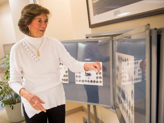 Former St. Mary's School of Nursing director Margaret Heins looks through photos of former students on display at Physicians Regional Medical Center.