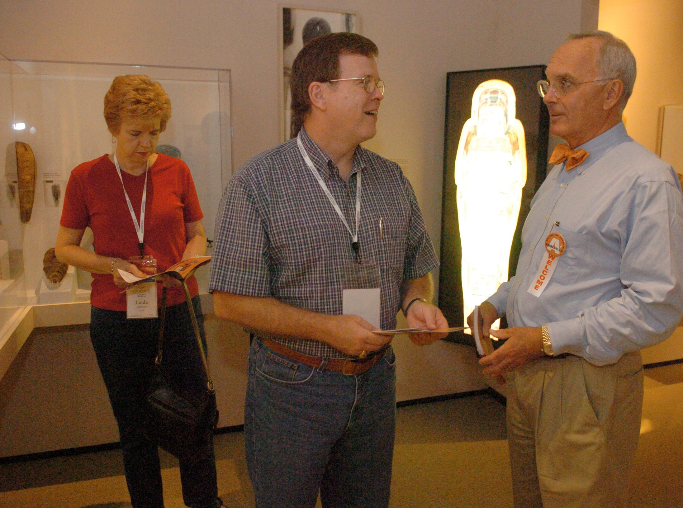 Linda and Don Andrews of Chattnooga pause to talk with Jefferson Chapman, Ph.D. Director the Frank H. McClung Museum. Chapman was answering Andrews questions about the Egiptain artifacts now on display at the Museum.