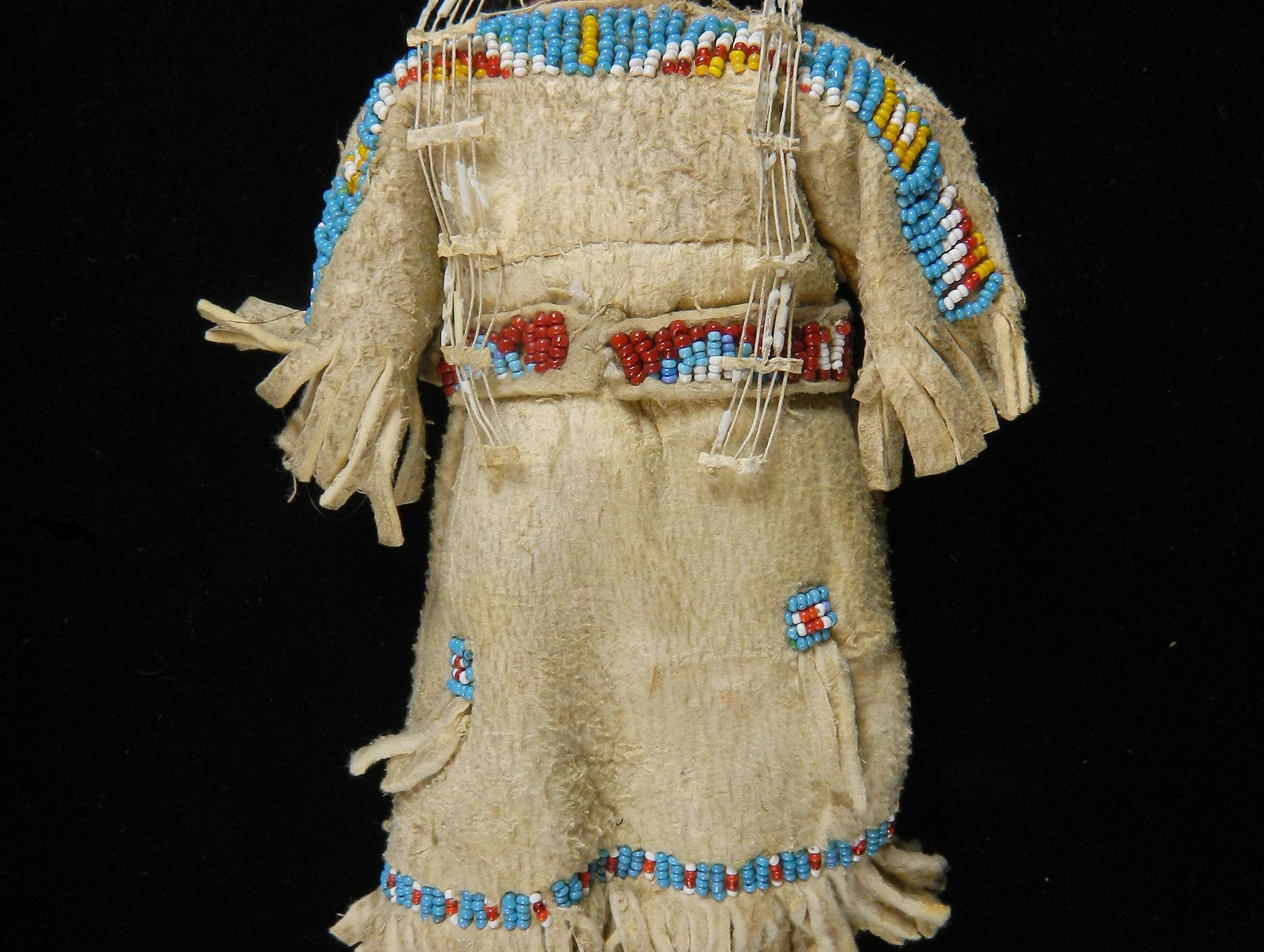 "This toy doll created by a member of the Lakota Indians is part of a new exhibit at the McClung Museum of Natural History and Culture. ""Brightly Beaded: North American Indian Glass Beadwork"" is shown at the University of Tennessee museum through June 1."
