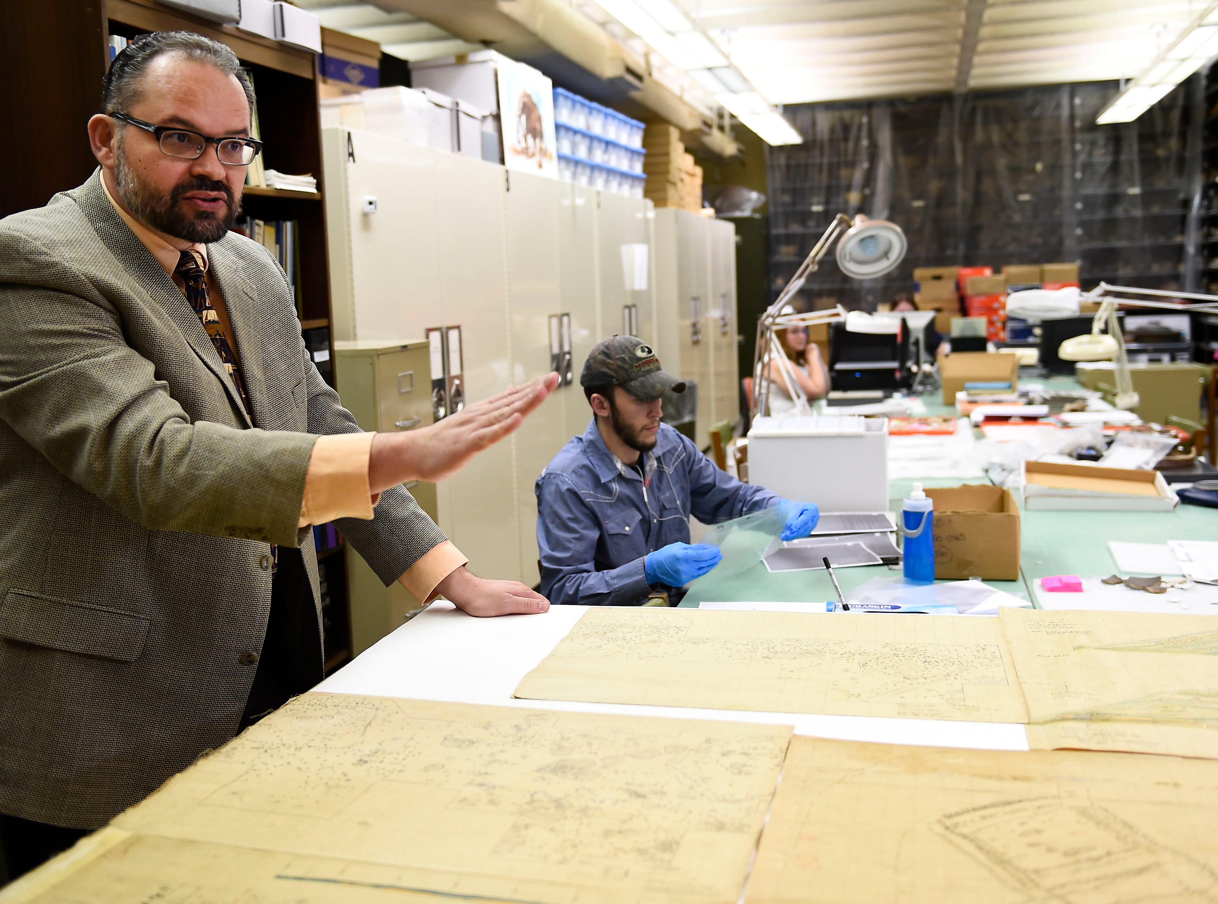McClung Museum curator Tim Baumann, left, describes maps drawn in the 1930's of the Hiwassee Island archaeological site on Thursday, Nov. 20, 2014 in Knoxville, TN. The McClung Museum, in partnership with the Tennessee Valley Authority, are working to preserve artifacts excavated during the creation of many of TVA's reservoirs.
