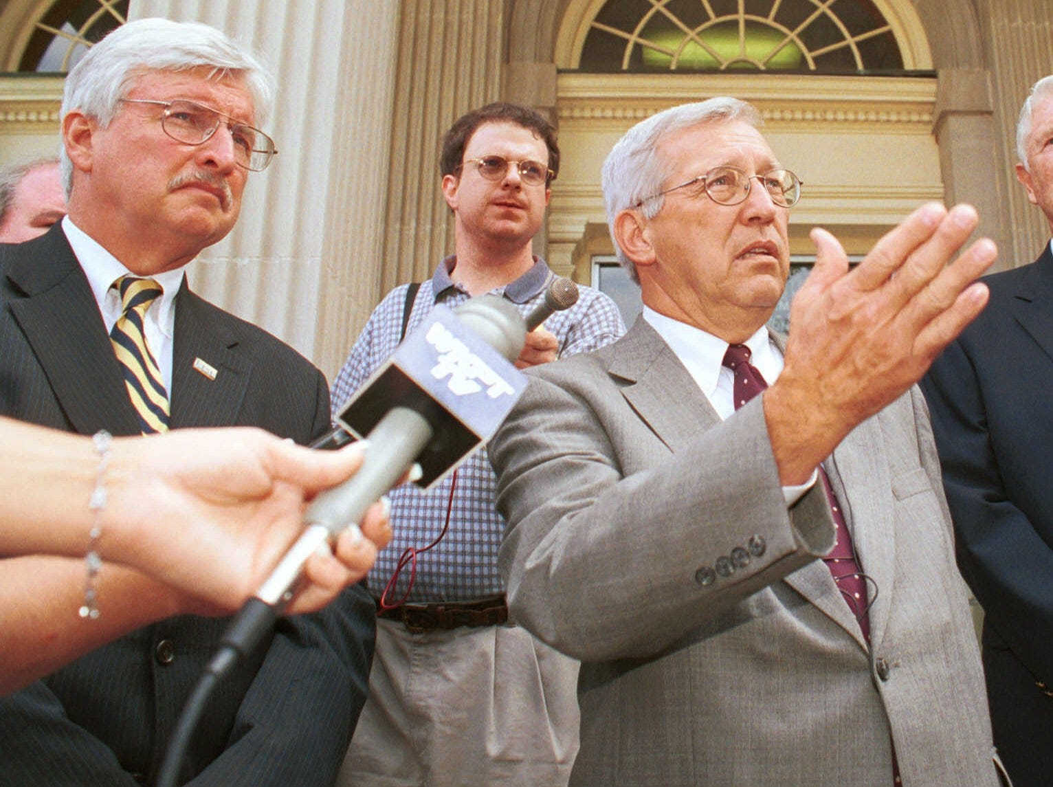 Tennessee Gov. Don Sundquist talks to the reporters outside the old Charles Sherrod Library at East Tennessee State University in Johnson City, Tenn., Tuesday, July 24, 2001 as  Dr. Paul Stanton, left,  president of the University and state Rep. Zane Whitson of Erwin, Tenn., right look on.  The old building has not been able to be converted to new space due to the recent budget cuts.  (AP Photo/Earl Neikirk)