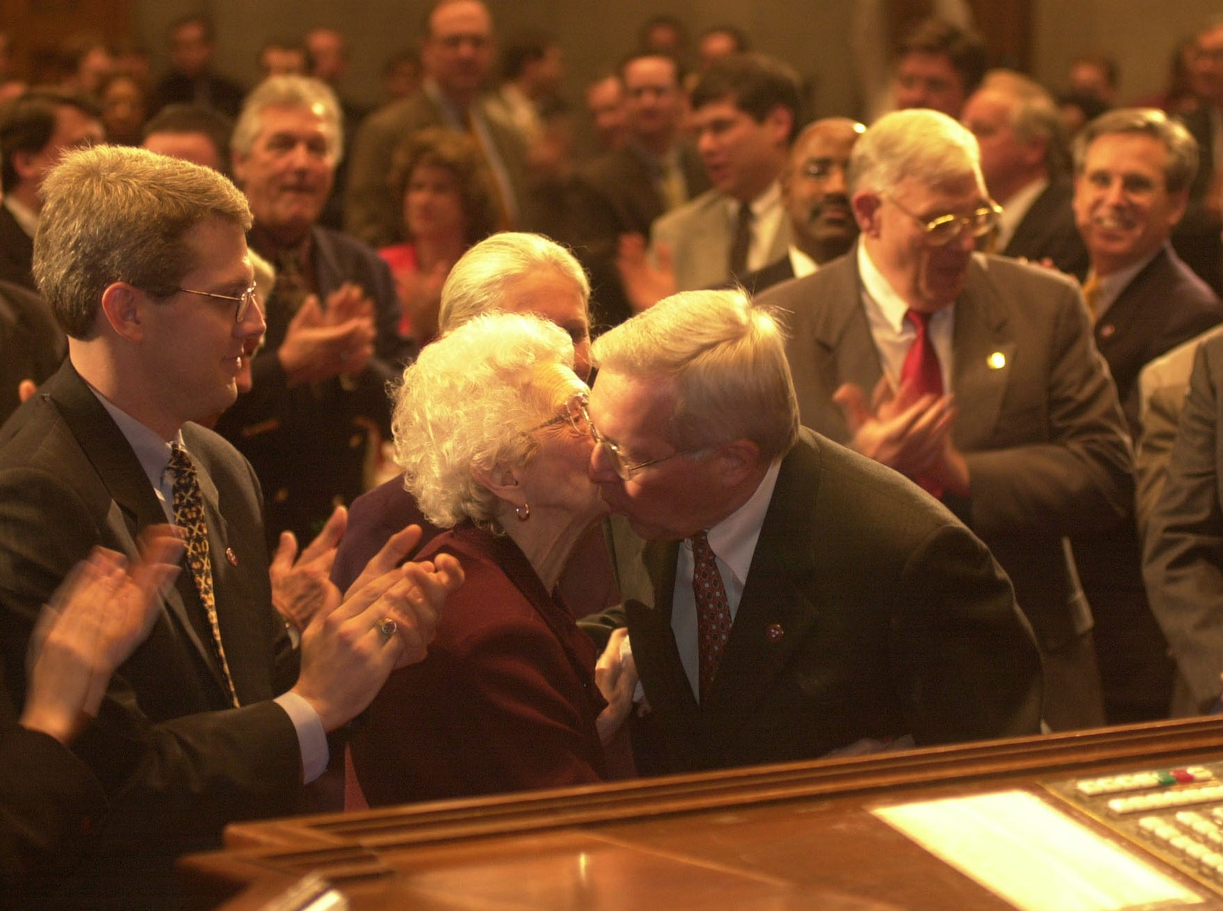 Tennessee Govenor Don Sundquist gives a kiss to his mother, Louise Sundquist, as he enters the House Chambers for his annual State of the State address Monday night.