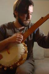 Matt Morelock plays a banjo that he made from a gourd.