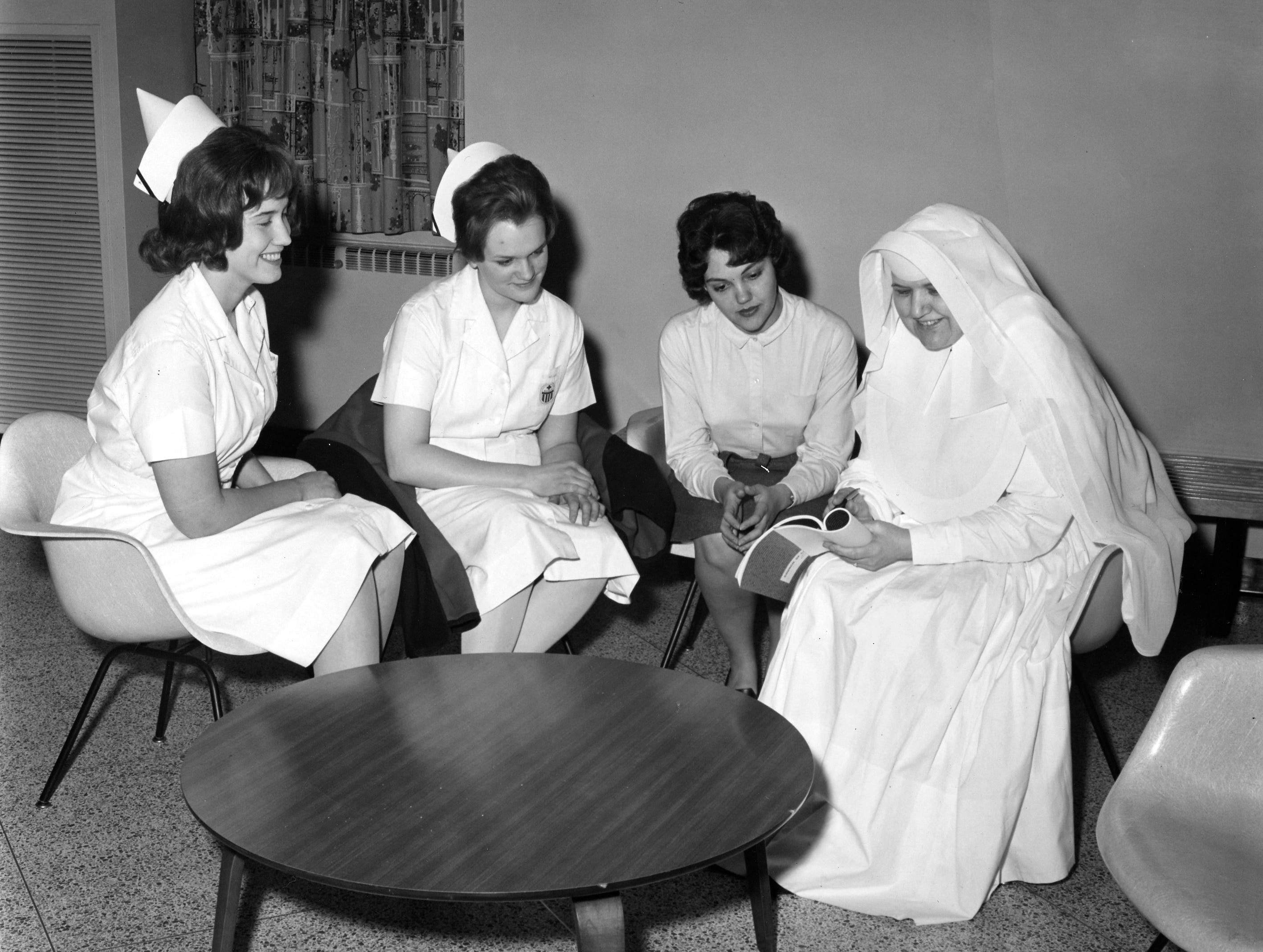 Sister Mary Assisium with 3 student nurses, 1965