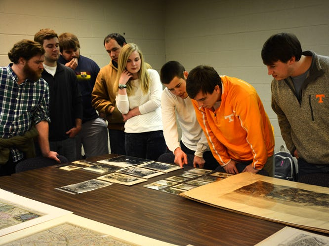 University of Tennessee students in Jovana Babovic's Central European Cities class discuss political power, cultural perception and urban development as they view 17th- and 18th-century maps recently at the McClung Museum.