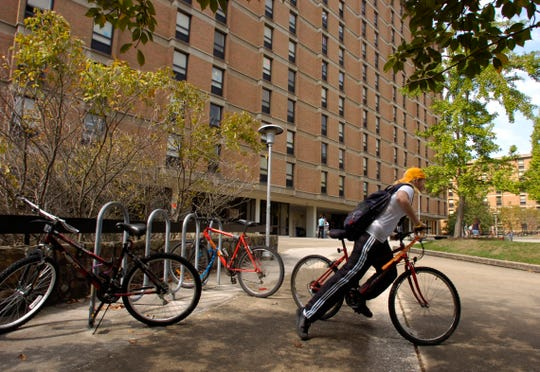 Marla Woolfolk, a forestry and wildlife freshman at the University of Tennessee, peddles her bike away from Carrick Hall, Wednesday. A consulting firm has recommended that UT spend more than $200 million over the next 17 years to revamp its entire housing system. 9/28/05