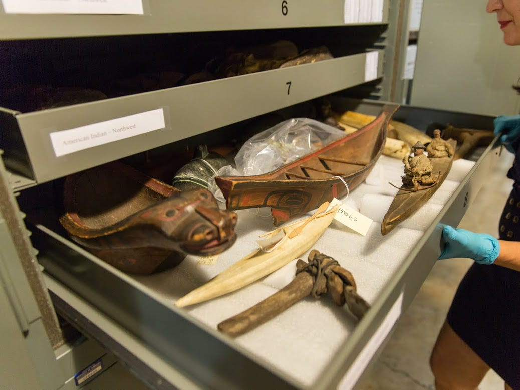 University of Tennessee researcher Christine Dano Johnson shows a Native Alaskan artifacts Wednesday, June 17, 2015, at the McClung Museum of Natural History and Culture. Johnson, a rising UT senior, has spent several summers researching the origins of McClung's Alaskan artifacts.