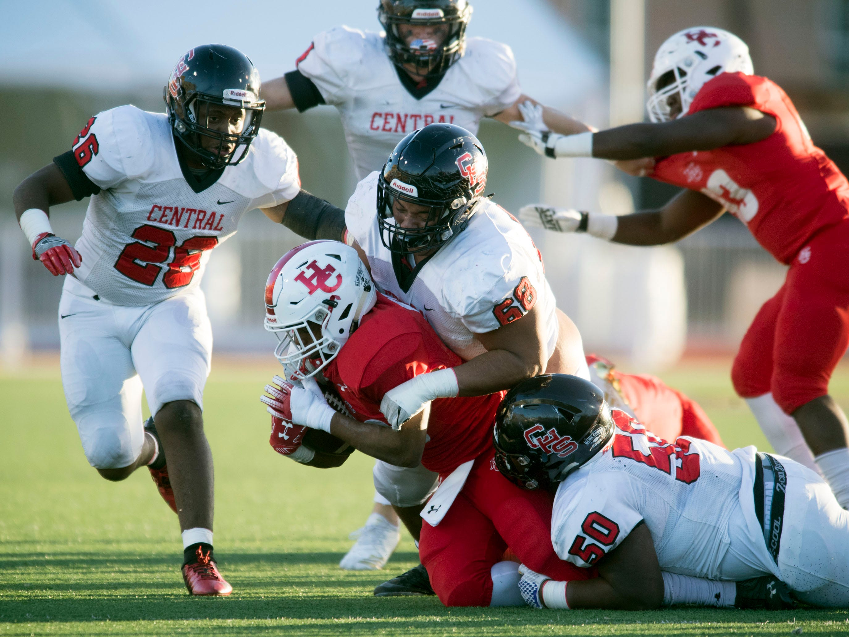 Henry County's Jermarcus Johnson (48) is tackled by Knoxville Central's Jakobi Troutman (68), and Jalynn Clemons (50) in the Class 5A BlueCross Bowl at Tucker Stadium on Sunday, December 2, 2018.