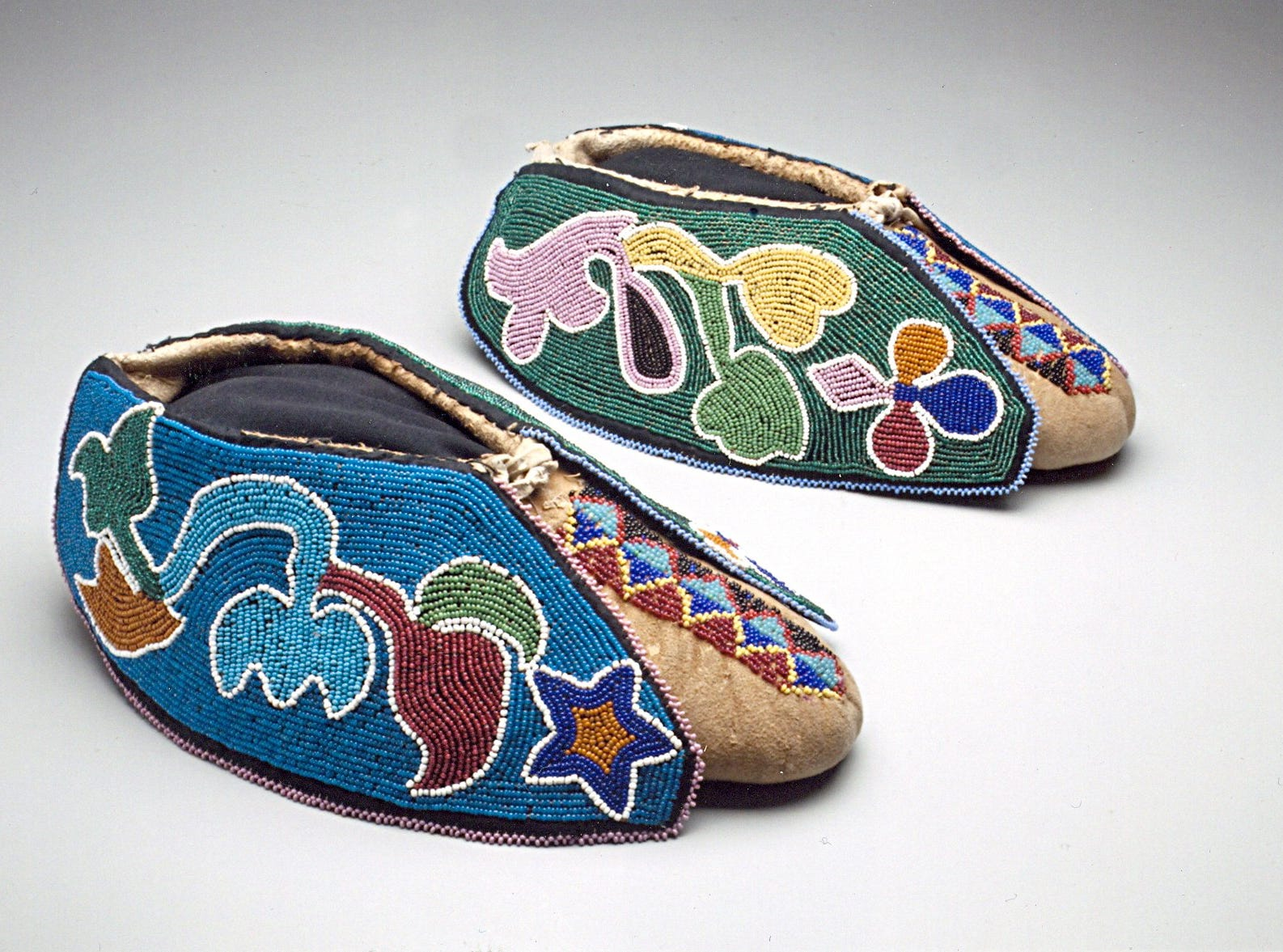 "Hese Potawatomi appliqued moccasins are part of ""Brightly Beaded: North Amiercan Indian Glass Beadwork"" showing at the McClung Museum. A display of moccasins from different tribes illustrate the different techniques and decorating styles of Native Americans."