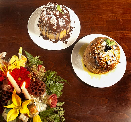 Sarino Italian restaurant owner and executive chef Carmelo Gabriele's panettones, traditional Italian Christmas bread deserts: at left is the milk chocolate ganache and at right, a white chocolate ganache. 17 November 2018