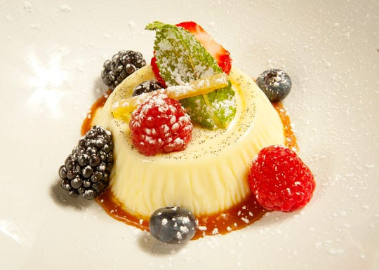 Sarino's Italian restaurant owner and executive chef Carmelo Gabriele pannacotta is a traditional Italian custard made with white vanilla bean and white chocolate served atop a salted caramel sauce. The dish is topped with berries, a leaf of mint and a candied orange peel and then dusted with confectionary sugar.