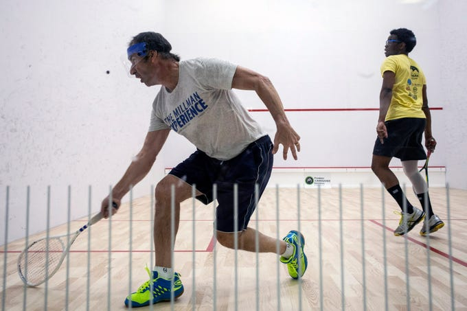 """Richard Millman, the squash pro at Scenic City Squash in Chattanooga, takes on Kudzaishe """"Kay Zee"""" Sitshebo from Indianapolis during a heated match at the Louisville Boat Club. 11/10/18"""