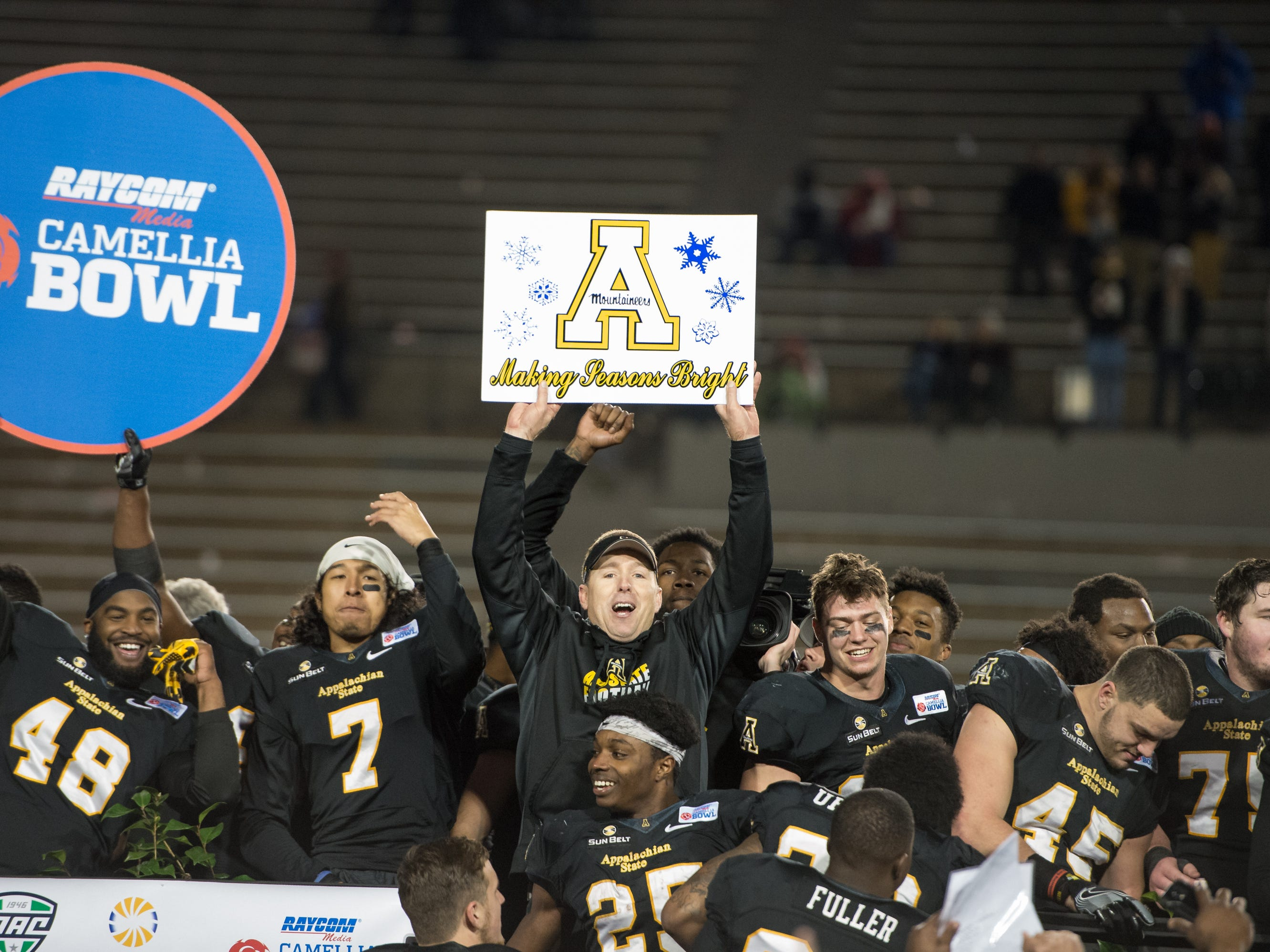 MONTGOMERY, AL - DECEMBER 19: Head coach Scott Satterfield # of the Appalachian State Mountaineers celebrate with his team after defeating the Ohio Bobcats on December 19, 2015 during the Raycom Media Camellia Bowl at the Cramton Bowl in Montgomery, Alabama. The Appalachian State Mountaineers defeated the Ohio Bobcats 31-29.  (Photo by Michael Chang/Getty Images)