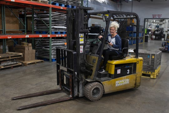 """""""Let's just hope I don't crash into the wall,"""" Nowling said with a laugh as she looks to learn to drive a fork lift at her new job at American Plastics. The company has a tradition of giving people second chances, and Nowling is grateful to be employed full time. Nov. 5, 2018"""