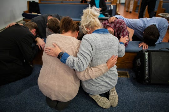 Nowling prays in the floor at the altar in the New Frankfort Pentecostal Church in Austin, Indiana. Oct. 17, 2018