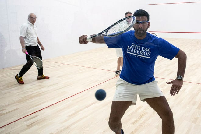 Ozair Shariff focuses on a wild ball during a doubles match of squash at the Louisville Boat Club. 11/10/18