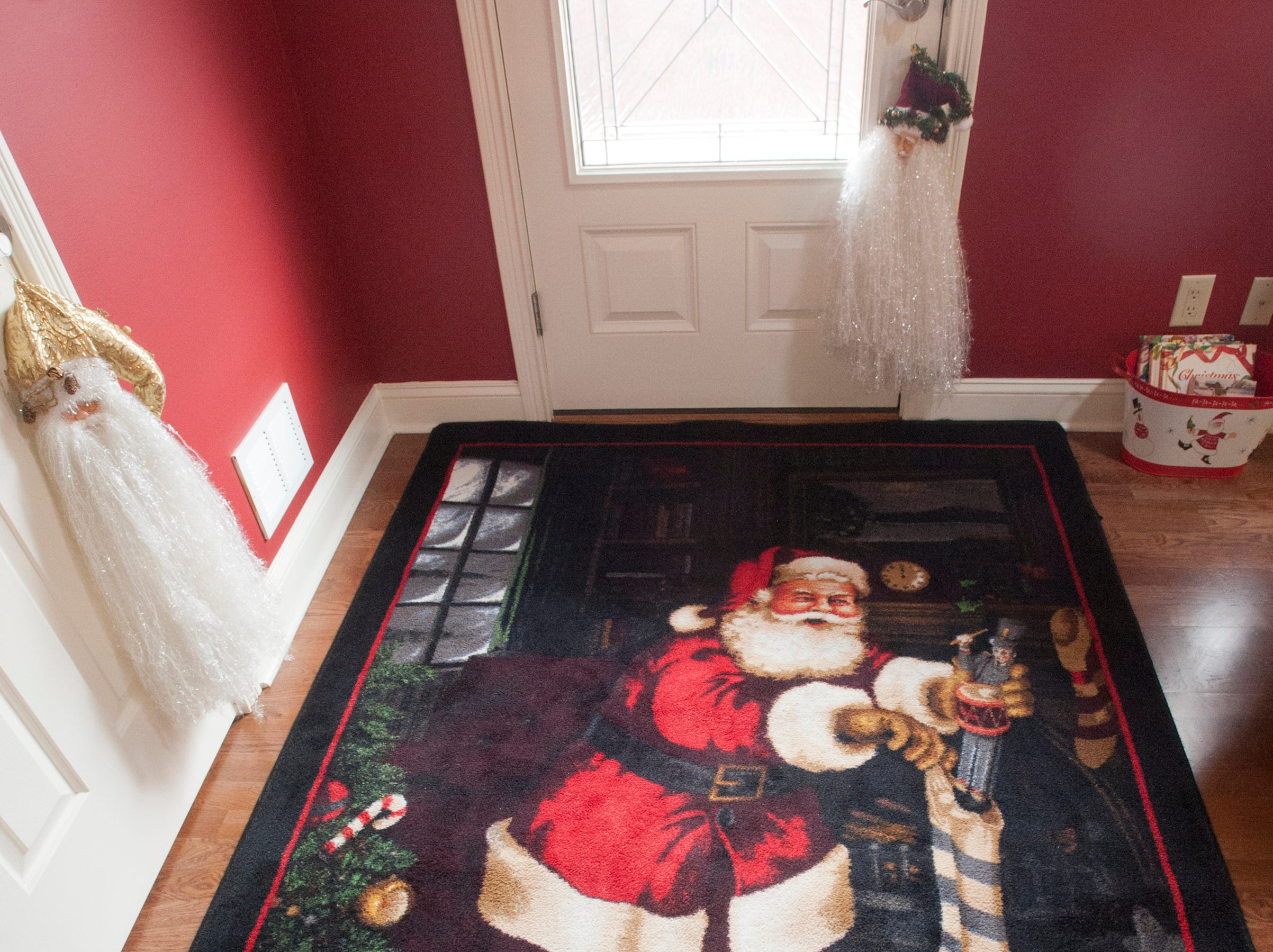 The entranceway of the McMurry home where a large Santa carpet welcomes visitors.