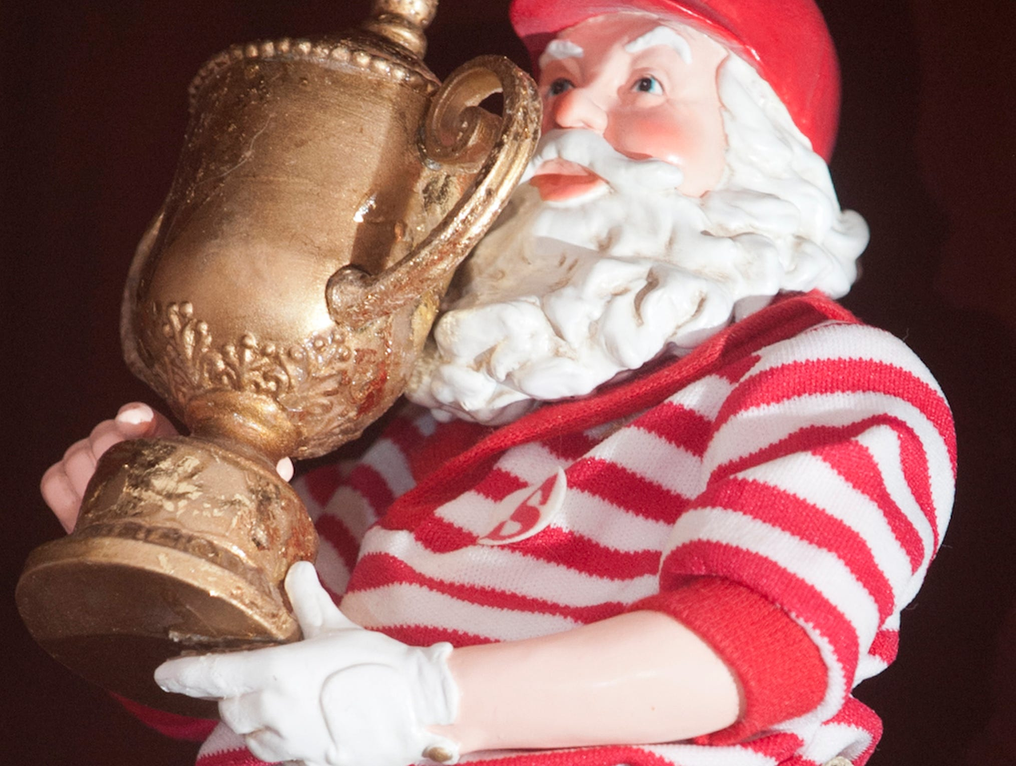 Santa celebrates his golf trophy in this figurine in Greg McMurry's home office.