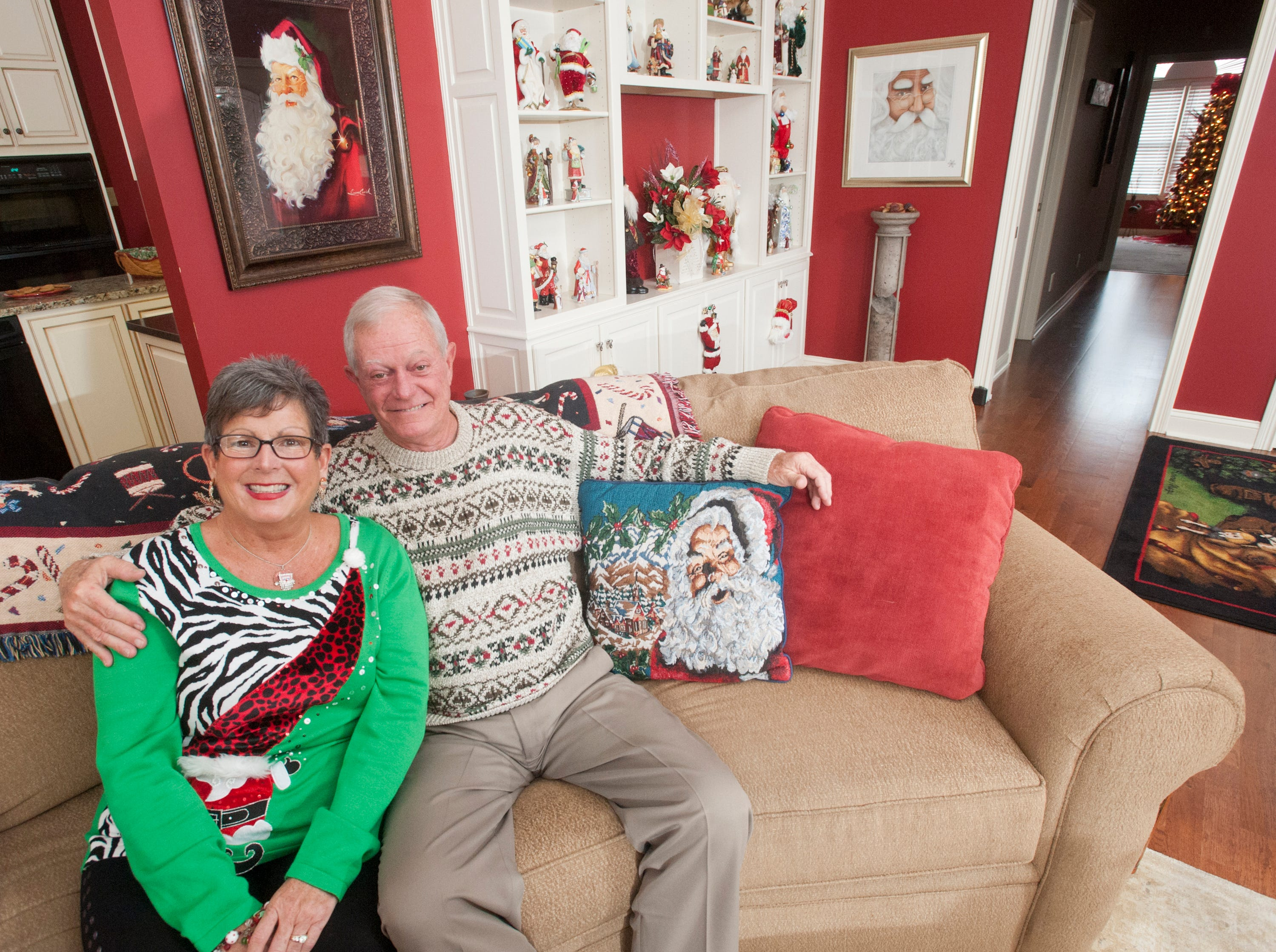 Teresa and Greg McMurry of Jeffersonville sit on their living room couch. Christmas decorating is a big tradition in their home. They've put up holiday items together for over 20 years.