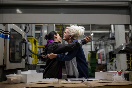 """Nowling has a laugh with fellow American Plastics' employee Nikki Stevens during their shift. It was an adjustment transitioning into factory work for Nowling, but she was recently promoted to a quality specialist position. """"Everything is completely new now, so I have to pray about how to deal with these things,"""" Nowling said. """"I pray for the people here, because a lot of people at my job are also in recovery and going through things."""" Nov. 5, 2018"""
