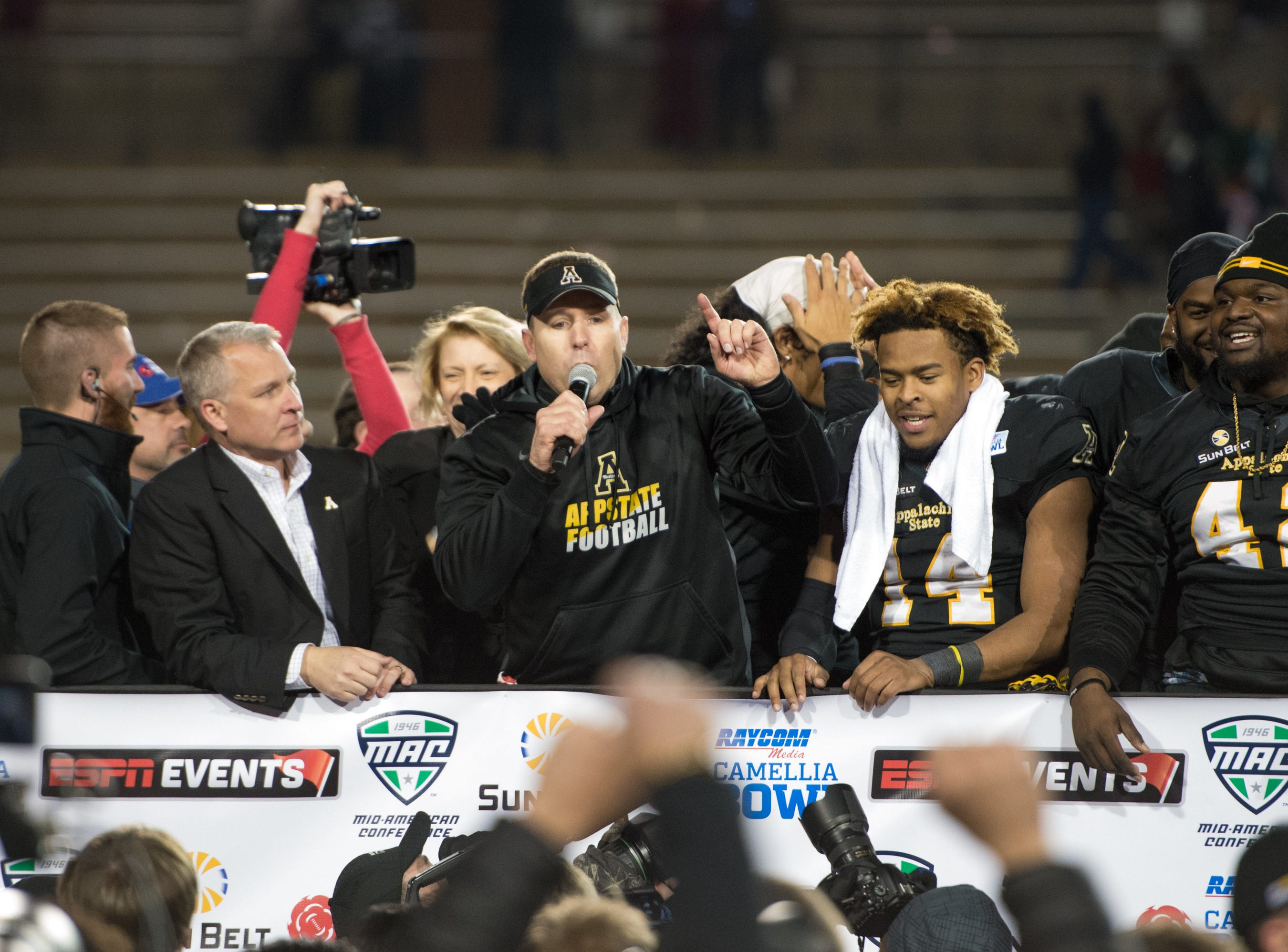 MONTGOMERY, AL - DECEMBER 19: Head coach Scott Satterfield of the Appalachian State Mountaineers talks to fans after defeating the Ohio Bobcats during the Raycom Media Camellia Bowl on December 19, 2015 at the Cramton Bowl in Montgomery, Alabama. The Appalachian State Mountaineers defeated the Ohio Bobcats 31-29.  (Photo by Michael Chang/Getty Images)