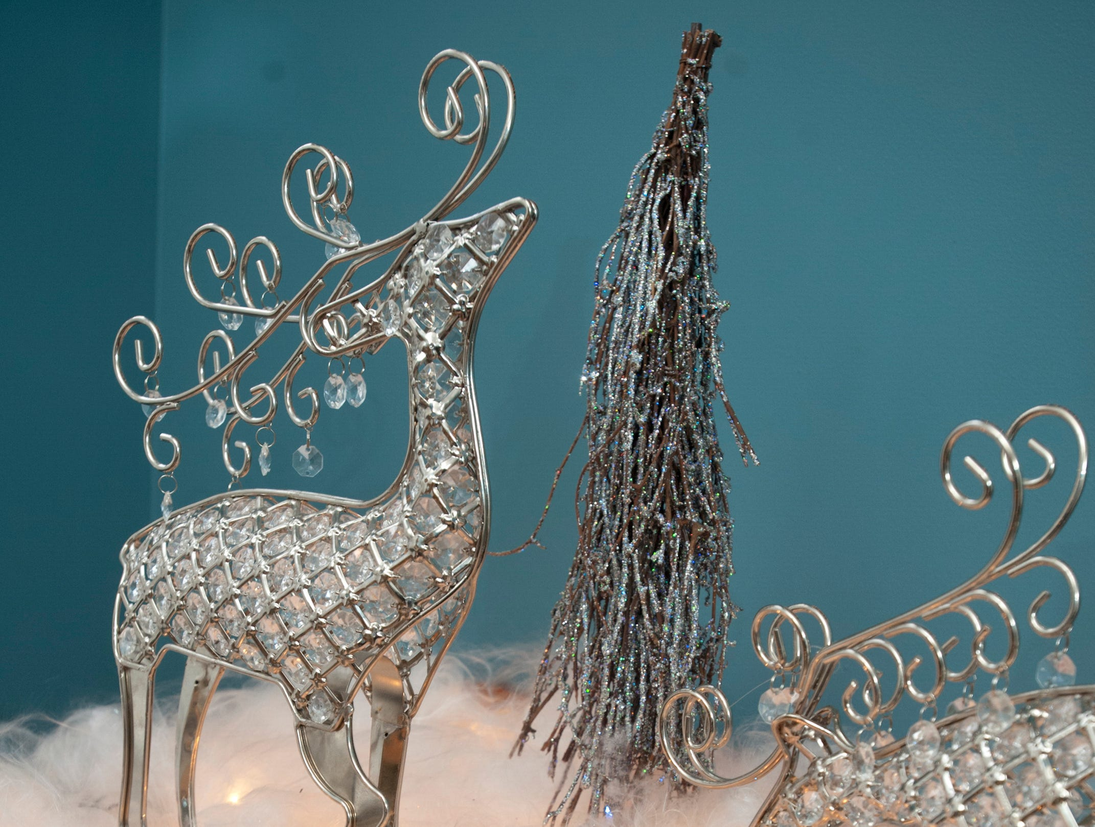 Metal reindeer decorate a side table in the McMurry guest room.