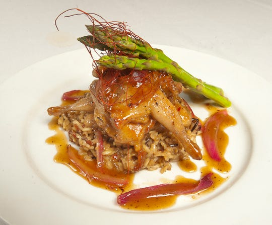 Buck's Restaurant and Bar Executive Chef Allen Sims' Quail on the Hill is made with a pan-seared quail served atop wild rice. The quail and dish is then spooned with red onion marmalade made from the deglazed quail pan. The dish is then topped with asparagus and mild chili threads.