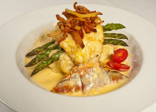 Buck's Restaurant and Bar Executive Chef Allen Sims' Kentucky Lawyer is made with a pan-seared lobster tail deglazed with bourbon and then cream to make the sauce. The tail is then placed atop a mashed potato base, arranged like a boat with asparagus as oars and the tail as a rudder, and then topped with julienned jowl bacon. The dish is accompanied by tomato halves.
