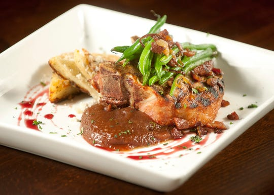 Sarino's Italian restaurant owner and executive chef Carmelo Gabriele's grilled pork chop is served atop a Woodford Reserve bourbon apple butter and finished with agrodolce (Italian sweet and sour sauce.) The dish is accompanied by potato au gratin, and topped with sautŽed green beans with crispy pancetta and caramelized onions.17 November 2018