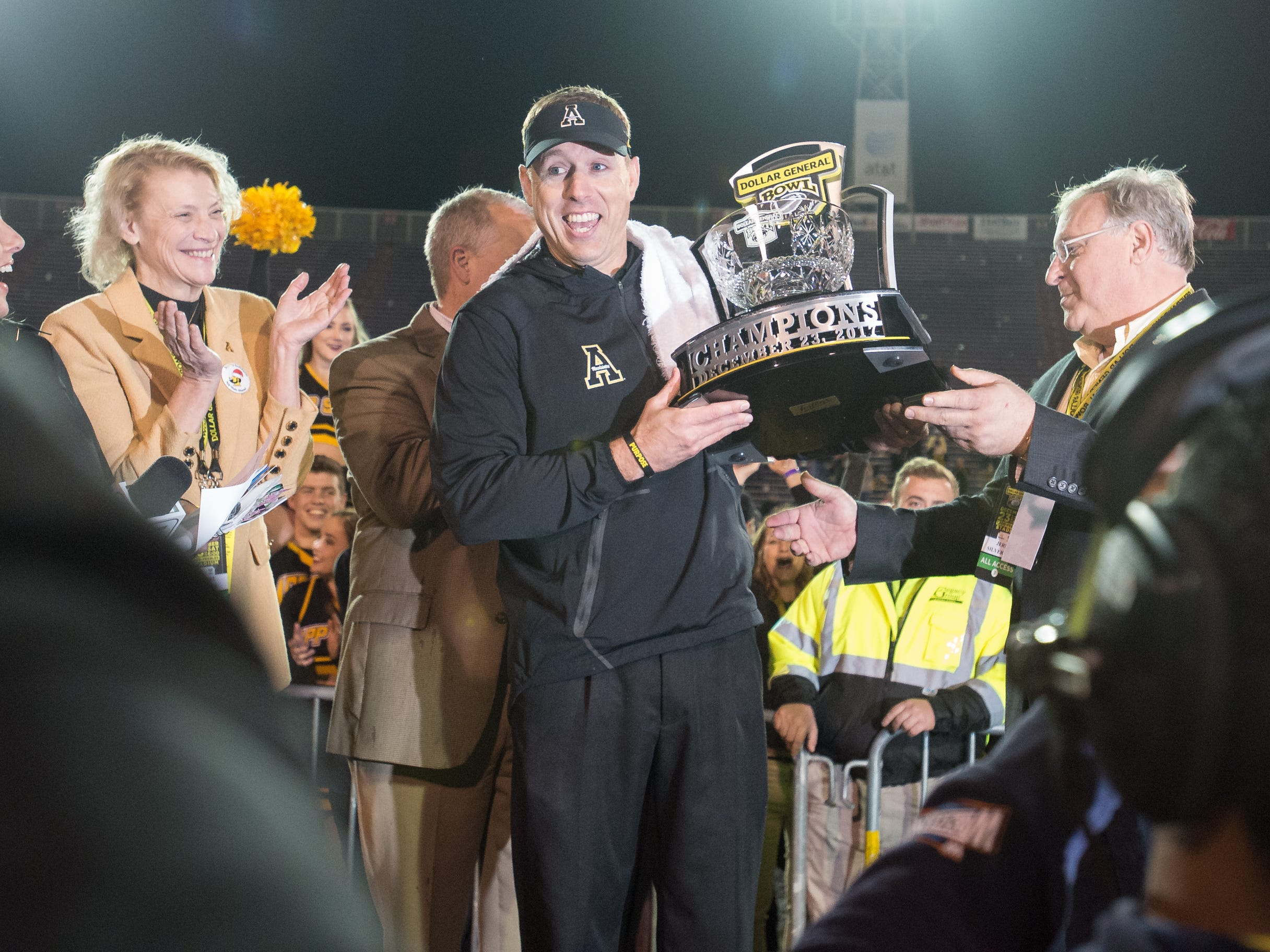 MOBILE, AL - DECEMBER 23: Head coach Scott Satterfield of the Appalachian State Mountaineers holds the Dollar General Trophy after defeating the Toledo Rockets on December 23, 2017 at Ladd-Peebles Stadium in Mobile, Alabama. (Photo by Michael Chang/Getty Images)