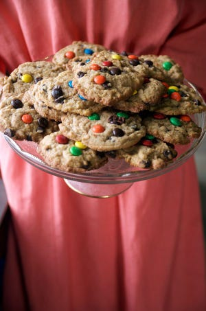 """This photo, from Lovina's """"The Essential Amish Cookbook,"""" shows a festive twist on chocolate chip cookies by adding colorful, candy-coated chocolate pieces."""